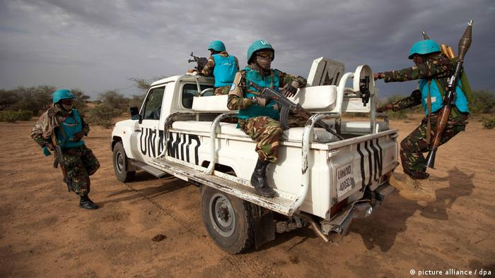 UNAMID troops from Tanzania conduct a routine patrol