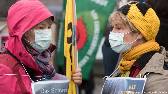 Two women at a climate protest with face mask