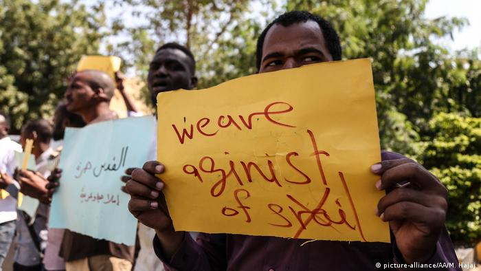 Protesters hold placards during a protest against meeting of Sudan's Sovereign Council Head Abdel-Fattah al-Burhan and Prime Minister of Israel Benjamin Netanyahu in Uganda
