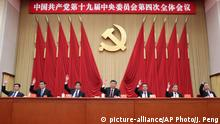 In this photo released by China's Xinhua News Agency, Chinese President Xi Jinping, center, and, from left, Politburo Standing Commitee members Han Zheng, Wang Huning, Li Zhanshu, Premier Li Keqiang, Wang Yang, and Zhao Leji attend the fourth plenary session of the 19th Central Committee of China's ruling Communist Party in Beijing, Thursday, Oct. 31, 2019. (Ju Peng/Xinhua via AP)