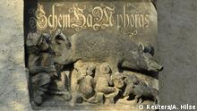 """A thirteenth century anti-Semitic sculpture is displayed at St. Marien church in Wittenberg, Germany, January 24, 2020. A court is expected to rule on a motion seeking the removal of the 700-year-old sculpture known as """"Judensau"""" or Jew pig. It is one of around 20 such relics from the Middle Ages that still feature on churches across Germany and elsewhere in Europe. A sign underneath the plaque urges people to think about the anti-Semitism that prevailed at the time it was made. Picture taken January 24, 2020. REUTERS/Annegret Hilse"""