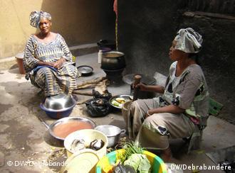 Two women in Mali cooking.
