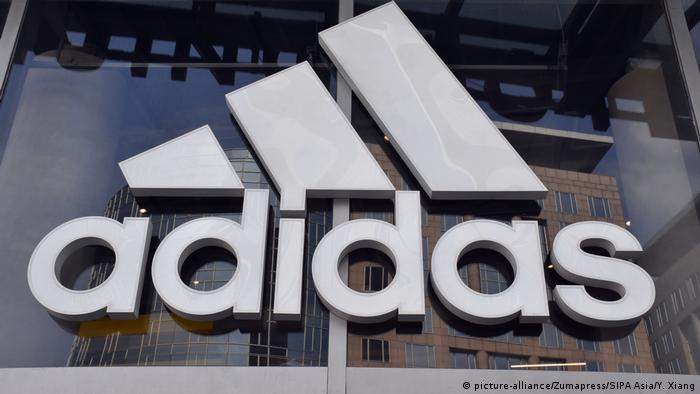 The Adidas logo in the front of a retail store