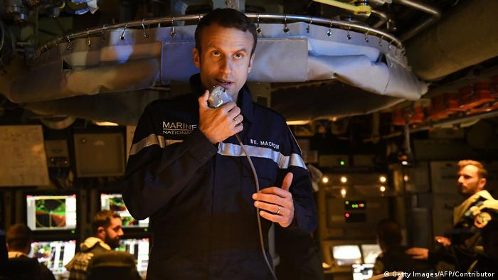 French President Emmanuel Macron speaks to the Captain and crew of the submarine Le Terrible from the operations centre of the vessel