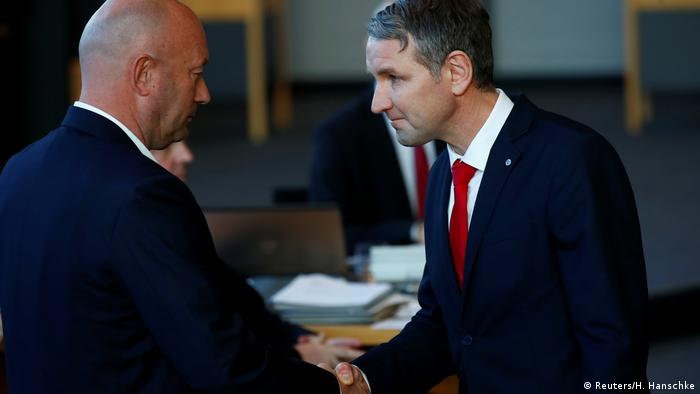 Björn Höcke, Alternative for Germany (AfD) party leader congratulates Free Democratic Party (FDP) candidate Thomas Kemmerich after he was elected new Thuringia premier at the state parliament in Thuringia in Erfurt, Germany, February 5, 2020.