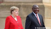 06.02.2020+++ German Chancellor Angela Merkel, arrives with South Africa's President Cyril Ramaphosa, for her state visit at the Union Buildings in Pretoria, South Africa February 6, 2020. REUTERS/Siphiwe Sibeko