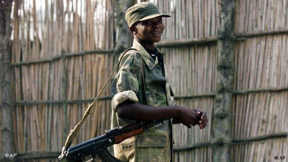 A young soldier from a Ugandan supported Congolese rebel movement group stands at an army base
