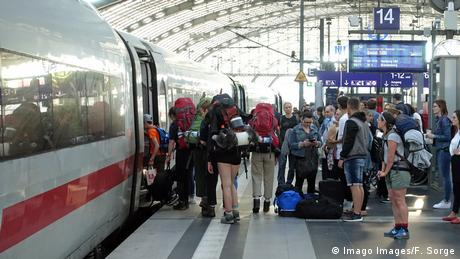 Passengers entering a German high-speed train at Berlin's central station.