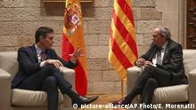 Spanish Prime Minister Pedro Sanchez, left, talks with Catalan regional President Quim Torra at the Palace of the Generalitat, the headquarter of the Government of Catalonia, in Barcelona, Thursday, Feb. 6, 2020. (AP Photo/Emilio Morenatti)  