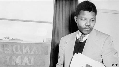 Jailed ANC leader, Nelson Mandela, pictured in 1952 at the law office he opened with his colleague, Oliver Tambo. This was the first black legal practice in Johannesburg, South Africa. Both were founding members of the African National Congress Youth League. The words ?Mandela? and ?Tambo? were written across the frosted window panes on the second floor ? an uncommon sight in South Africa at that time. (AP Photo/Jurgen Schadenberg)