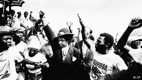 Winnie Mandela, wife of jailed ANC Leader Nelson Mandela, raises her fist during the funeral for 17 blacks who were buried, after being killed during fierce rioting on Wednesday, March 5, 1986 in South Africa Johannesburg's Alexandra black township(AP Photo) South Africa out