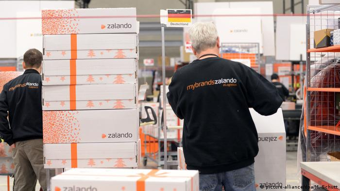 Workers at a Zalando warehouse are preparing packages