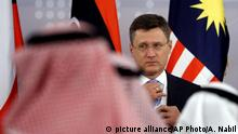 19.7.2019*** Russian Minister of Energy Alexander Novak adjusts his tie as he prepares for a group photo before ta meeting of energy ministers from OPEC and its allies to discuss prices and production cuts, in Jiddah, Saudi Arabia, Sunday, May 19, 2019. The meeting takes places as tensions flare in the Persian Gulf after the U.S. ordered bombers and an aircraft carrier to the region over an unexplained threat they perceive from Iran, which comes a year after the U.S. unilaterally pulled out of Tehran's nuclear deal with world powers and reimposed sanctions on Iranian oil. (AP Photo/Amr Nabil) |
