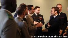 French President Emmanuel Macron, right, meets military officials at the Ecole Militaire Friday, Feb. 7, 2020 in Paris. French President Emmanuel Macron, who leads the European Union's only post-Brexit nuclear power, on Friday advocated a more coordinated EU defense strategy in which France, and its arsenal, would hold a central role. (AP Photo/Francois Mori,Pool) |