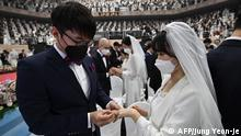 07.02.2020 *** Couples wearing protective face masks attend a mass wedding ceremony organised by the Unification Church at Cheongshim Peace World Center in Gapyeong on February 7, 2020. - South Korea has confirmed 24 cases of the SARS-like virus so far and placed nearly 260 people in quarantine for detailed checks amid growing public alarm. (Photo by Jung Yeon-je / AFP)