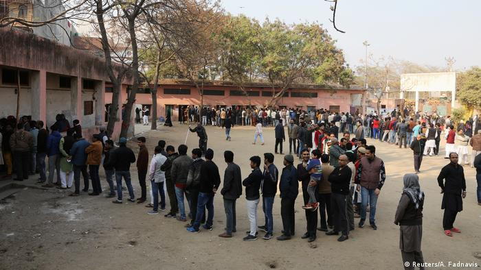 People line up to vote in state elections in New Delhi