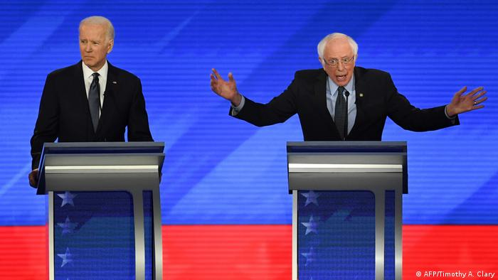 Bernie Sanders gestures and Biden look in the other direction during a debate (AFP/Timothy A. Clary)
