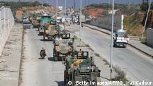 A Turkish military convoy of tanks and armoured vehicles passes near the city of Idlib, in northwestern Syria, near the Syria-Turkey border, on February 8, 2020. (Photo by Omar HAJ KADOUR / AFP) (Photo by OMAR HAJ KADOUR/AFP via Getty Images)