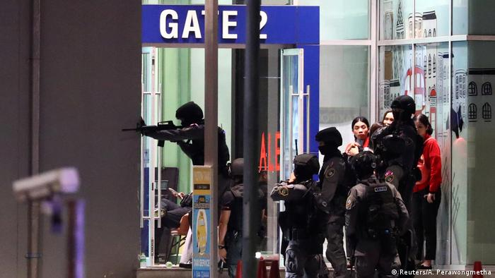 Security forces at the mall in Tunisia where a soldier opened fire (Reuters/A. Perawongmetha)
