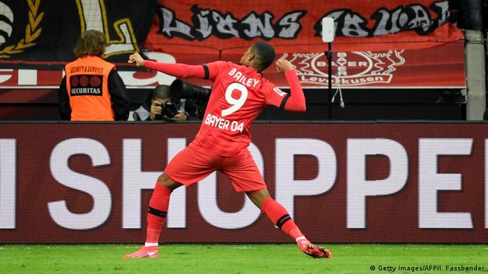 Leon Bailey celebrates scoring the third of Leverkusen's four goals against Dortmund