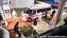 (200208) -- WUHAN, Feb. 8, 2020 () -- Patients enter the ward of Leishenshan (Thunder God Mountain) Hospital in Wuhan, capital of central China's Hubei Province, Feb. 8, 2020. The makeshift hospital received its first batch of patients of the novel coronavirus pneumonia Saturday night. (/Xiao Yijiu) |