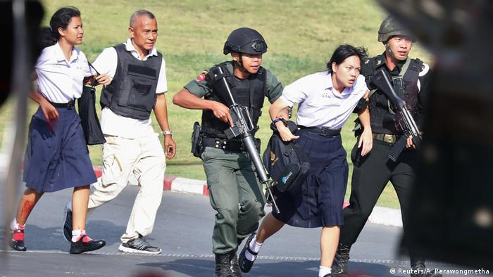 Thai security forces evacuate people from mall