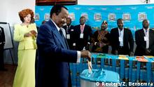 FILE PHOTO: Cameroonian President Paul Biya casts his ballot while his wife Chantal watches during the presidential election in Yaounde, Cameroon October 7, 2018. REUTERS/Zohra Bensemra/File Photo