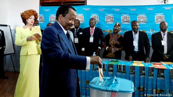 Cameroonian President Paul Biya casts his ballot during elections in 2018.