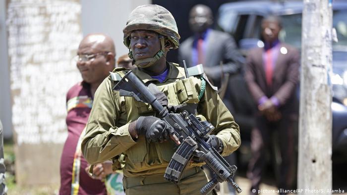 A Cameroonian soldier wielding a machine gun