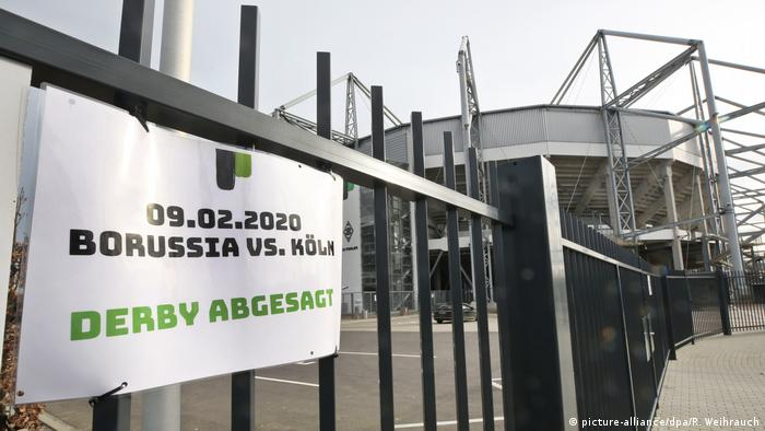 A sign saying that a football match between Borussia and Cologne is canceled