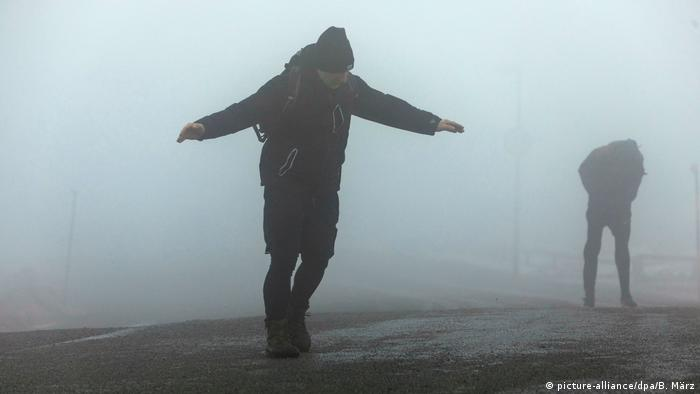 A man leans against the wind on Brocken