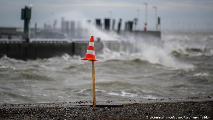 Waves crash against a jetty in Wilhelmshaven