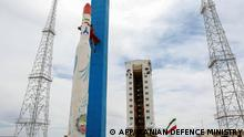 July 27, 2017*** (FILES) This file handout picture released by Iran's Defence Ministry on July 27, 2017 shows a Simorgh (Phoenix) satellite rocket at its launch site at an undisclosed location in Iran. - Iran started counting down on February 9, 2020 to the launch of a new scientific observation satellite scheduled within hours, the country's telecommunications minister said. The United States has raised concerns in the past about Iran's satellite programme, describing the launch of a carrier rocket in January 2019 as a provocation. (Photo by - / IRANIAN DEFENCE MINISTRY / AFP)
