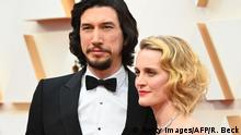 US actor Adam Driver and his wife actress Joanne Tucker arrive for the 92nd Oscars at the Dolby Theatre in Hollywood, California on February 9, 2020. (Photo by Robyn Beck / AFP) (Photo by ROBYN BECK/AFP via Getty Images)