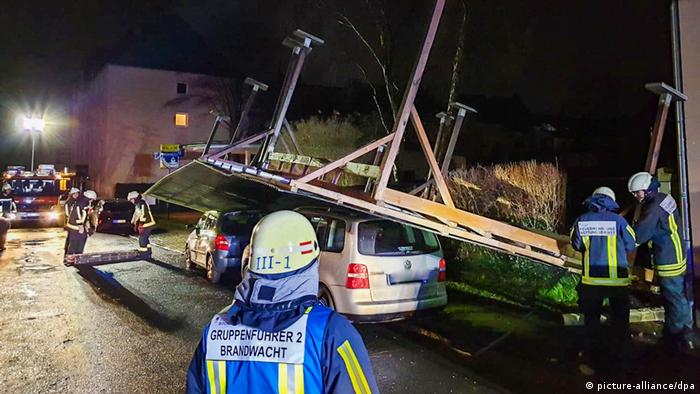 A carport blown over onto two vehicles in Germany by winter storm Sabine