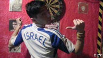 Aviv Netter wearing an Israel soccer shirt