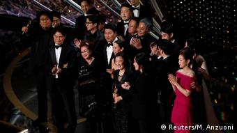 The team behind 'Parasite' came onstage to accept the Oscar for best picture (Reuters/M. Anzuoni)