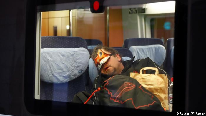 Man sleeps with eye mask in ICE train
