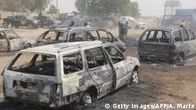 Nigeria | Niedergebrannte Fahrzeuge in Auno