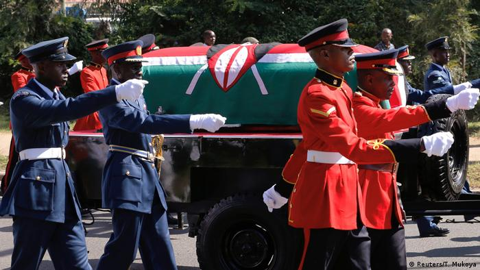 Military officers escort a gun carriage carrying the coffin of late former Kenya's President Daniel Arap Moi, draped in the national flag, during a state funeral procession in Nairobi