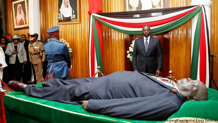 Kenya's Deputy President William Ruto pays his last respect to the body of late former Kenya's President Daniel Arap Moi, as it lays in state in Nairobi