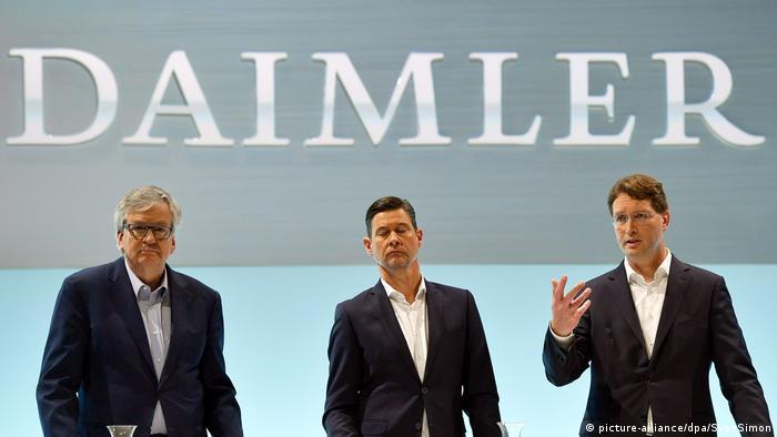 Daimler managers Martin Daum, Harald Wilhelm and Ola Kaellenius adressing a shareholders' meeting