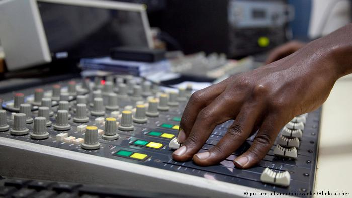 Photo of a a hand on a radio mixer