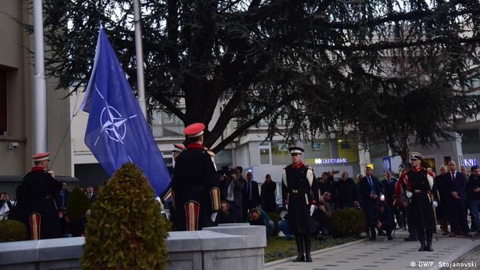 Soldiers in front of NATO flag in Skopje