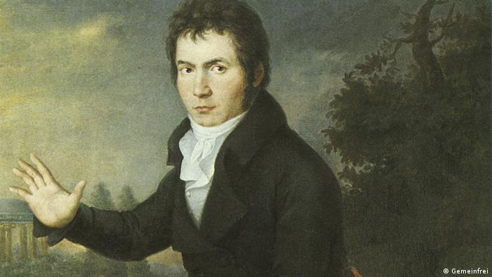 A painting of Ludwig van Beethoven holding up his hand.