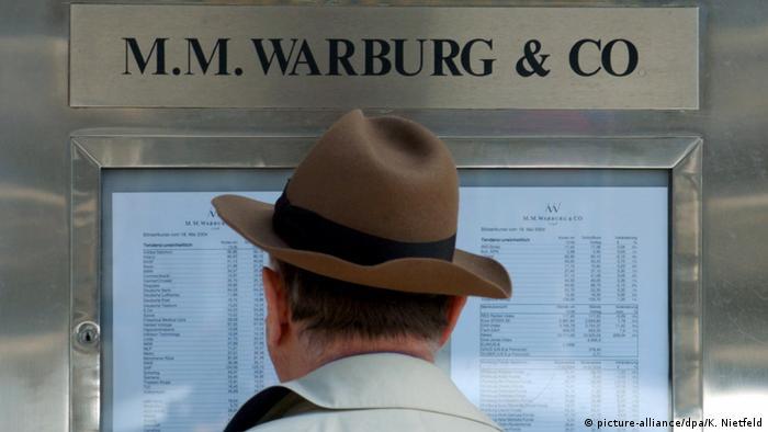 man standing in front of bank in Hamburg