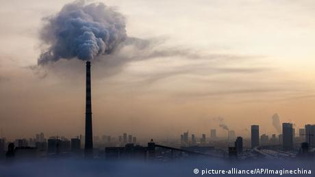 Waste gas is emitted from a chimney in heavy smog in China's Changchun city