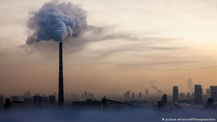Waste gas is emitted from a chimney in heavy smog in Changchun, China