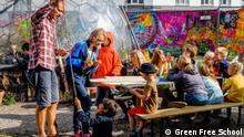 Children learn outside at the Green Free School in Copenhagen, Denmark