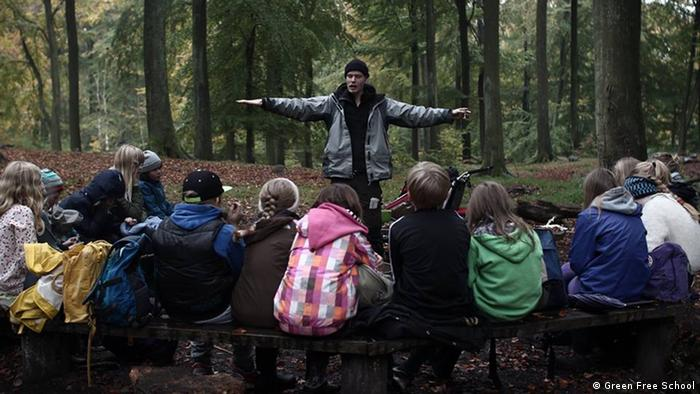 Pupils from the Green Free School attend a lesson in the woods in Copenhagen, Denmark